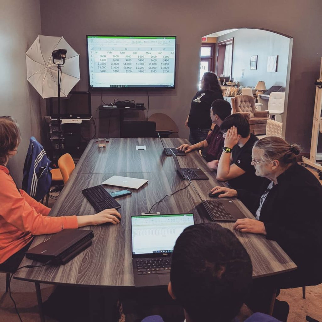 Members of the winter TECH Launch cohort receive training in Microsoft Excel from Christina Lopez, CEO, Boundless Connections.